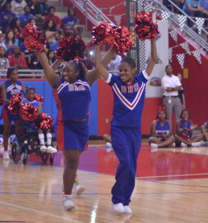 Sparkler Cheerleaders pump up the crowd at a pep rally. They received a standing ovation at every event they cheered at this year. (Tomica Charles photo)
