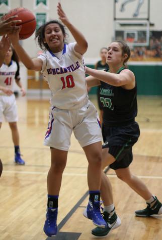 Junior Nina Alvarez pulls the ball down during the Southlake game. (Karla Estrada photo)